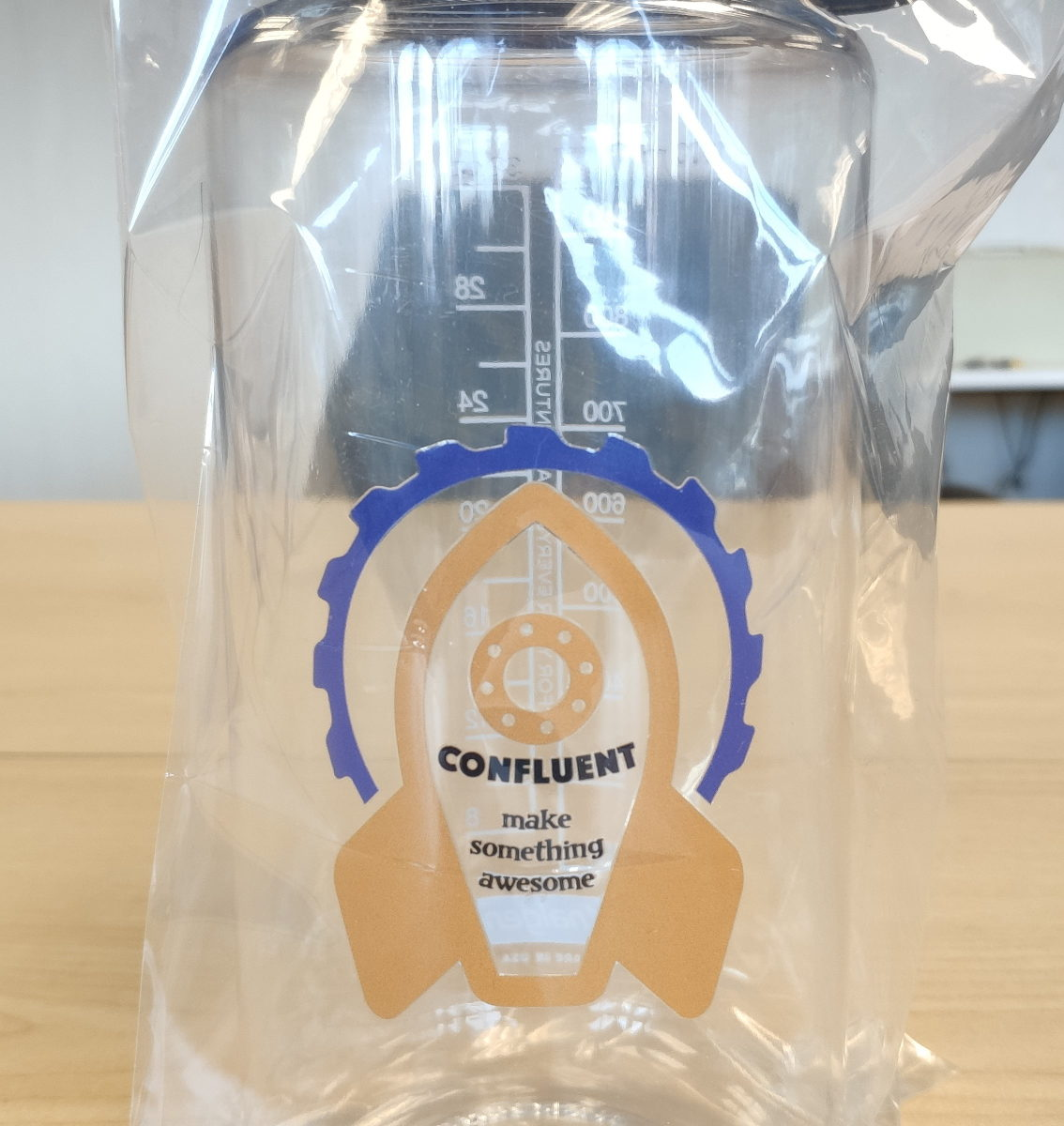 """Nalgene bottle printed with a rocket design that says """"Confluent"""" and """"make something awesome"""""""