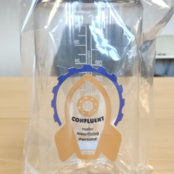"Nalgene bottle printed with a rocket design that says ""Confluent"" and ""make something awesome"""