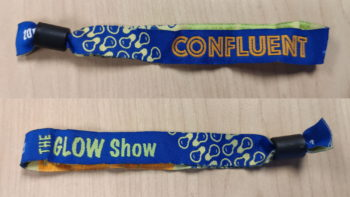The Glow Show fabric wrist band showing both sides